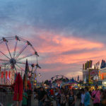 Scenic sunset photo overlooking the Carnival at the Greene County Fair