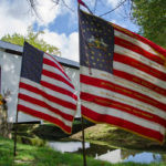 American Flags in front of the White Covered Bridge